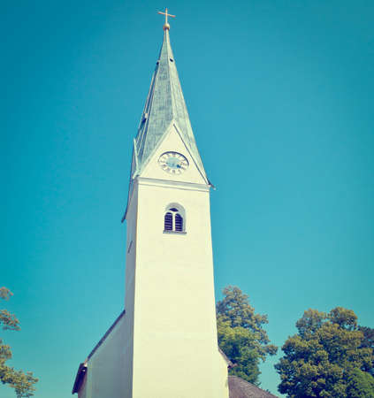Christian Church with Clock Tower in Southern Bavaria. photo