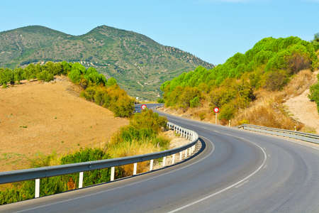 Winding Asphalt Road in the Mountains, Spain photo