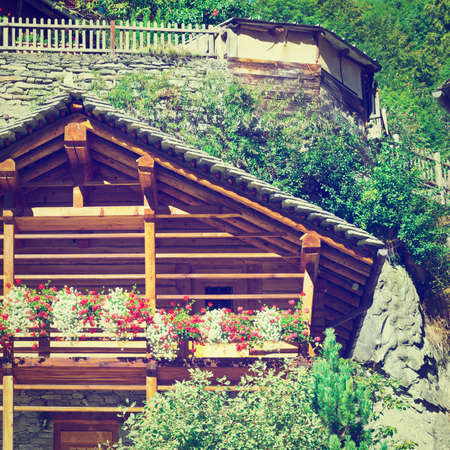 Wooden Loft Decorated With Fresh Flowers in the Italian Alps,  photo