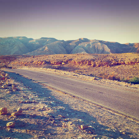 judean hills: Meandering Road in Sand Hills of Judean Mountains, Sunset,