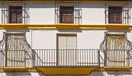 Facade with Balcony of the Old Spain House photo