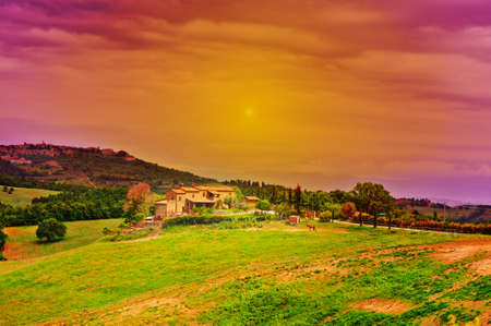 Big Farmhouse Surrounded by Fields in Tuscany at Sunset photo