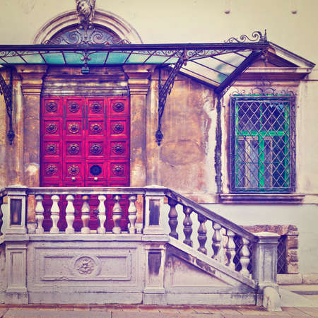 Glass Overhang over the Porch of an Old House in the Italian City of Vicenza photo