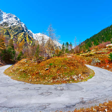Abrupt Bend in the Asphalt Road in the Italian Alps photo