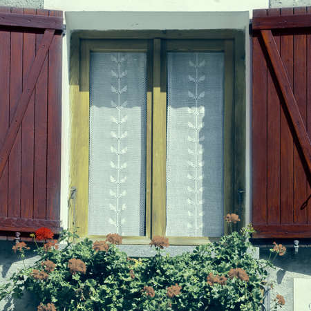 resplendence: Italian Window with Open Wooden Shutters, Decorated With Fresh Flowers, Vintage Style Toned Picture