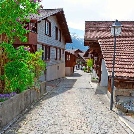 cobblestone street: Street with Old Wooden Buildings in Swiss Village