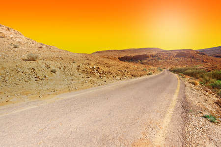 judean hills: Meandering Road in Sand Hills of Judean Mountains at Sunset