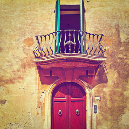 crumbling: Balcony on the Facade of the Old Italian House with Crumbling Plaster. Stock Photo