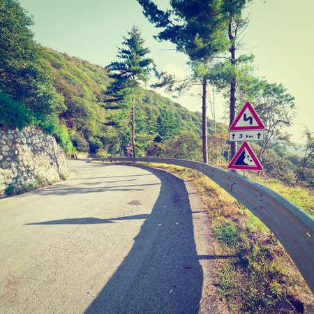 Winding Asphalt Road in the Italian Alps photo