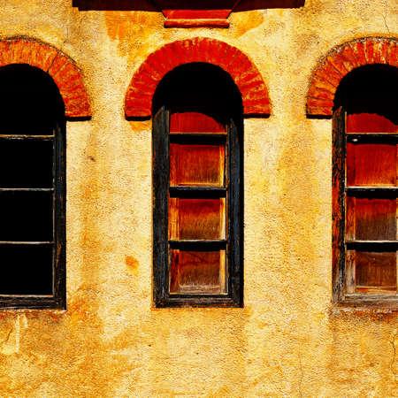 resplendence: Windows on the  Facade of the Old Spain House
