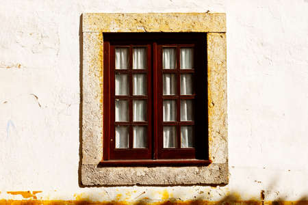 resplendence: Window on the Facade of the Old Portugal House