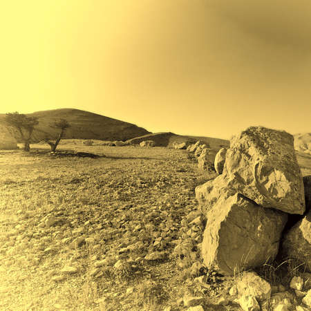 Big Stones of a Desert in Israel at Sunset, Vintage Style Toned Picture photo