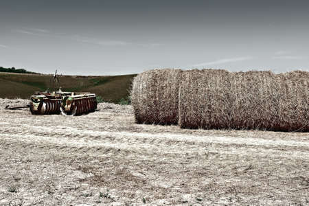 harrow: Landscape with Harrow and Hay Bales in Tuscany, Vintage Style Toned Picture