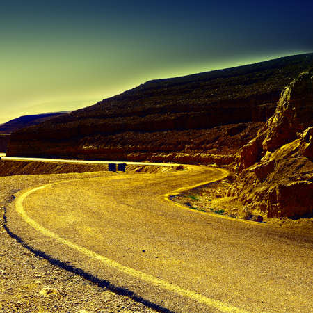 judean hills: Meandering Road in Sand Hills of Judean Mountains at Sunset, Israel, Vintage Style Toned Picture