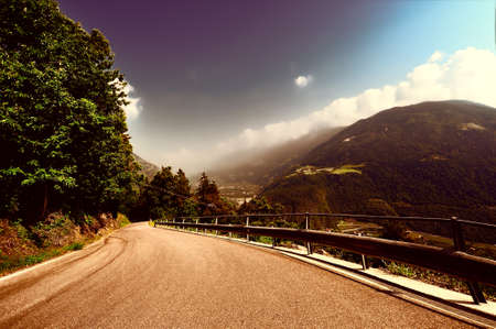 Winding Paved Road in the Italian Alps, Retro Image Filtered Style photo