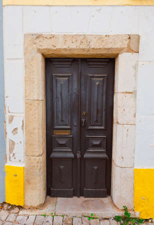 resplendence: Wooden Door in the Wall of Portuguese Home Stock Photo