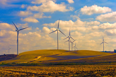 energy picture: Modern Wind Turbines Producing Energy in Spain at Sunset, Vintage Style Toned Picture Stock Photo