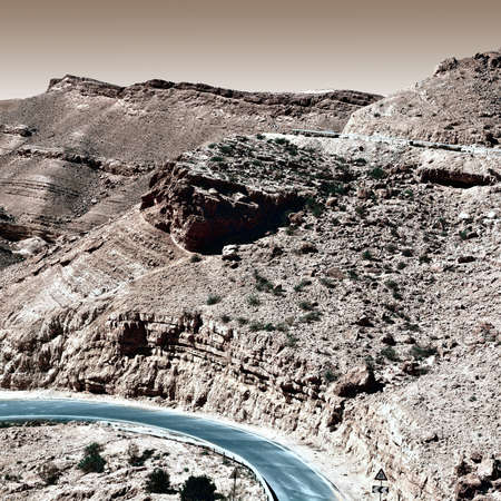 canyon negev: Winding Asphalt Road in the Negev Desert in Israel, Vintage Style Toned Picture Stock Photo