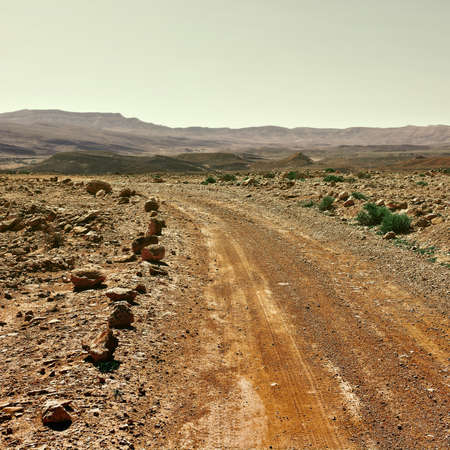 nature reserves of israel: Dirt Road in the Negev Desert in Israel, Vintage Style Toned Picture Stock Photo