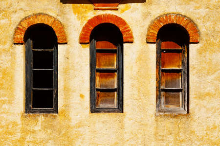 resplendence: Windows on the  Facade of the Old Spain House