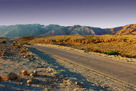 judean hills: Meandering Road in Sand Hills of Judean Mountains, Sunset Stock Photo