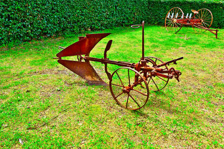 winnower: Old Agricultural Machines on a Green Grass Stock Photo