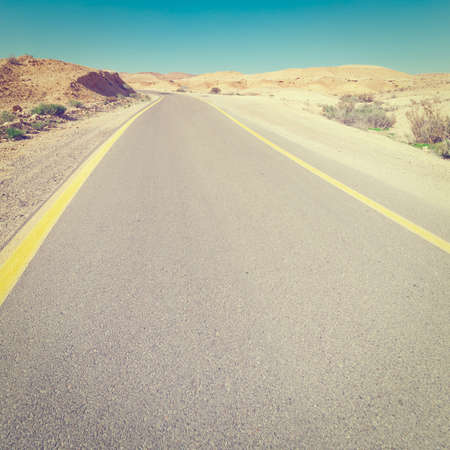 judean hills: Meandering Road in Sand Hills of Judean Mountains, Israel Stock Photo