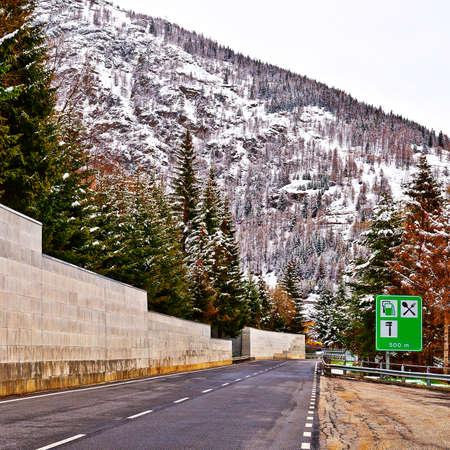 saint bernard: Saint Bernard Pass on the Background of Snow-capped  Italian Alps Stock Photo