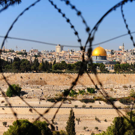 mount of olives: View From the Mount of Olives on the Dome of the Rock Through the Barbed Wire in Jerusalem, Israel