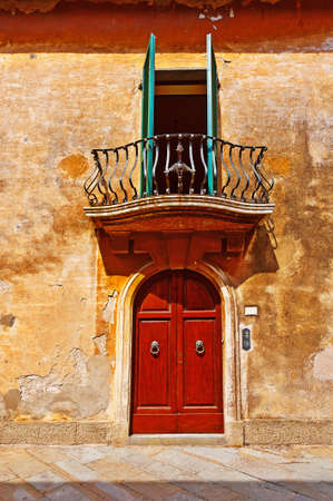 resplendence: Balcony on the Facade of the Old Italian House with Crumbling Plaster