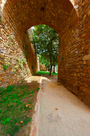 archway: Archway in the Wall in Medieval Portuguese City of Logos Stock Photo