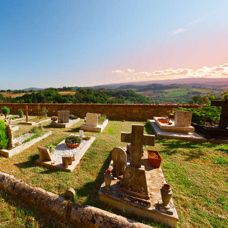 churchyard: Churchyard on the Background of the Tuscan Landscape at Sunset