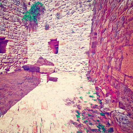 renewed: Courtyard of the Fortress in Italian City of Gimignano, Vintage Style Toned Picture