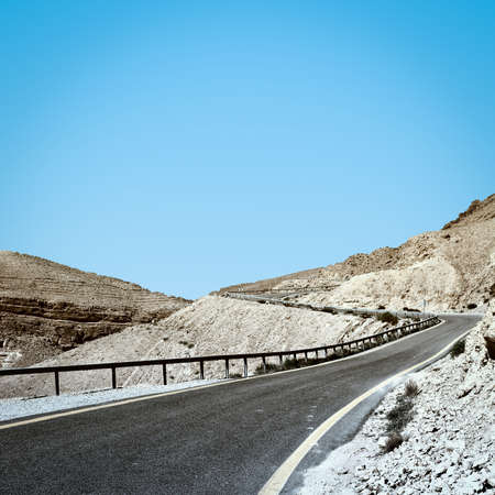 negev: Winding Asphalt Road in the Negev Desert in Israel, Vintage Style Toned Picture Stock Photo