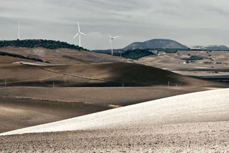 energy picture: Modern Wind Turbines Producing Energy in Spain, Vintage Style Toned Picture