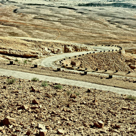 judean hills: Meandering Road in Sand Hills of Judean Mountains, Israel, Retro Image Filtered Style Stock Photo