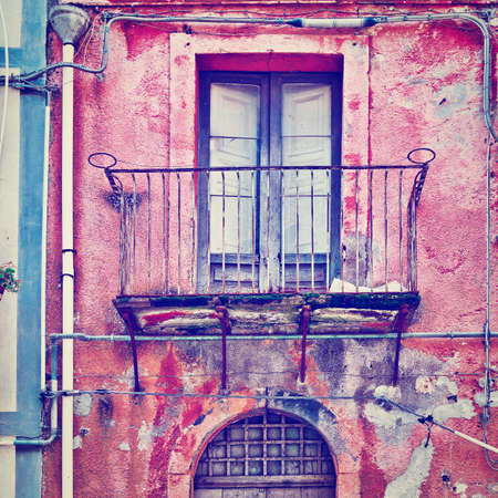 unsightly: Unsightly Facade of the Old House in Sicilian City of Piazza Armerina
