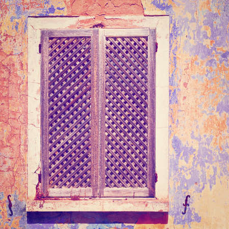 poorness: Window on the Peeling Facade of the Old Portugal House   Stock Photo