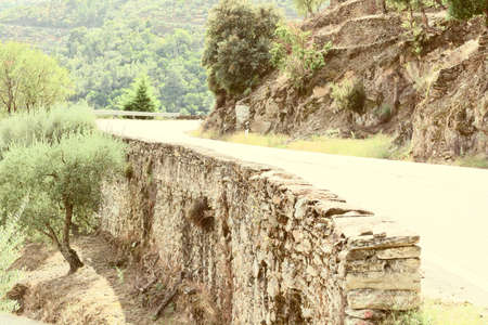 retaining: Retaining Wall for Mountain Asphalt Road in Portugal, Retro Image Filtered Style