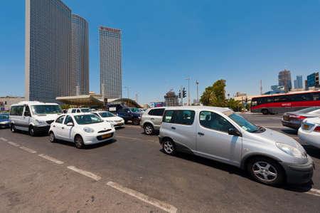 azrieli: TEL AVIV, ISRAEL- JULY 15, 2015  Traffic on the Shalom Bridge on the background of Azrieli Skyscrapers Complex