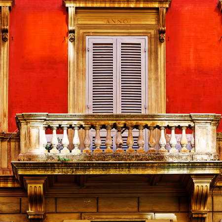 resplendence: Facade of the Old Italian House with Balcony in Rome