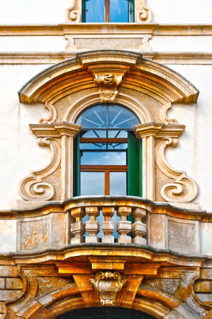 renovated: The Renovated Facade of the Old Italian House with Balcony