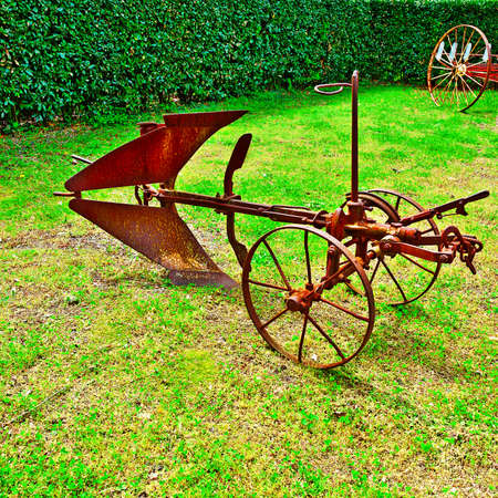 winnowing: Old Agricultural Machines on a Green Grass Stock Photo