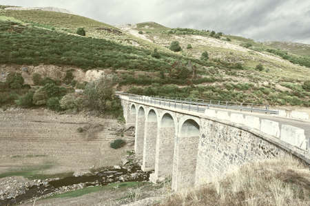 cantabrian: Bridge on the Bottom of Canyon in the Cantabrian Mountains, Vintage Style Toned Picture Stock Photo