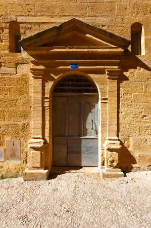 pediment: Solid Wooden Door Decorated with Pediment in the French City