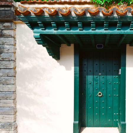 renewed: Wooden  Spanish Door in the Small City