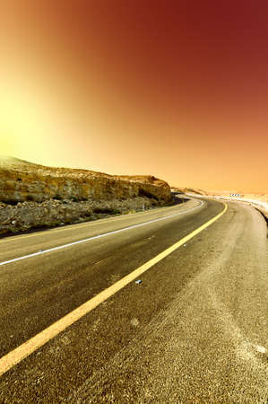 judean desert: Asphalt Road in the Judean Desert on the West Bank at Sunset, Vintage Style Toned Picture