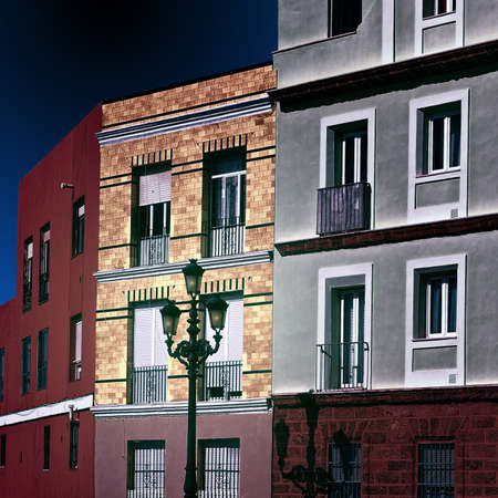 balcony window: Facades of the Houses in the Spanish City of Cadis at Night, Retro Image Filtered Style