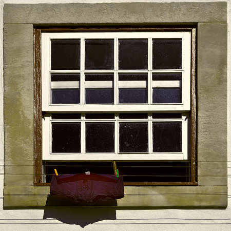 resplendence: The Men Underwear for Drying in Front of a Window, Vintage Style Toned Picture Stock Photo