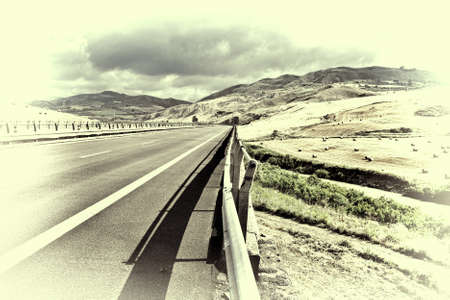 country highway: Landscape of Sicily with Highway and Many Hay Bales, Retro Image Filtered Style Stock Photo